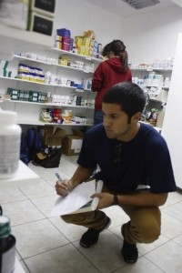 Students working in the pharmacy | Photo by Flying Samaritans.