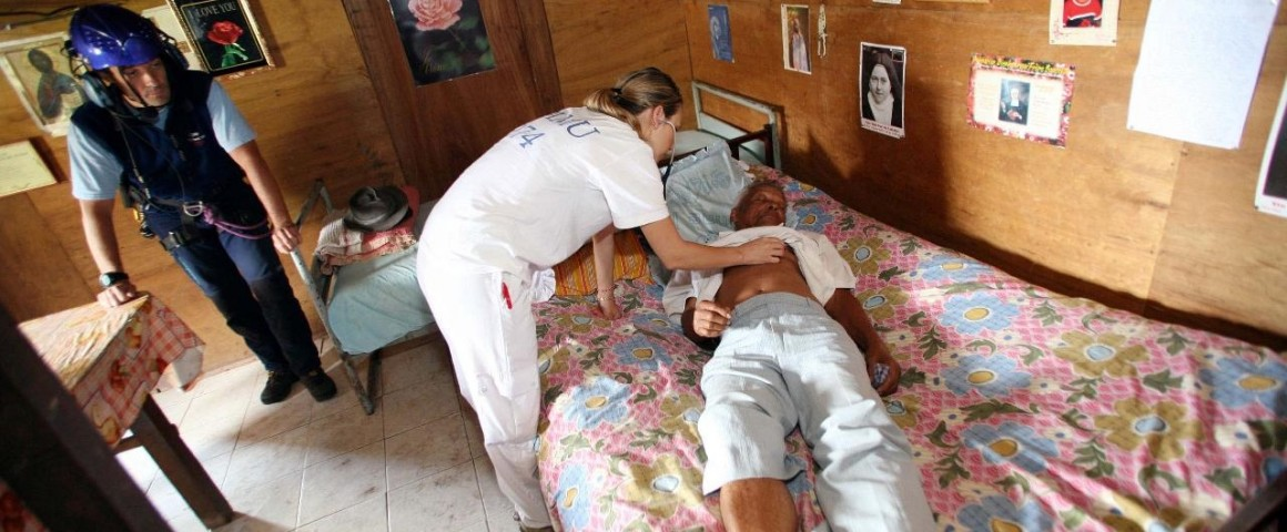 Health workers examining a patient with Chikungunya