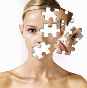 Woman with 'jigsaw-pieces' missing from face (Digital Composite)